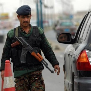 A Yemeni soldier checks vehicles near Sanaa International Airport on August 6, 2013 in Yemen (AFP File Photo)