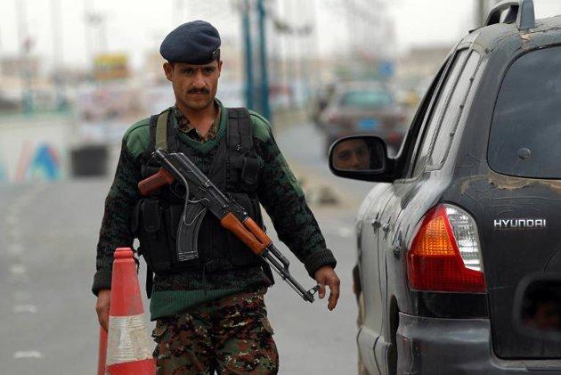 A Yemeni soldier checks vehicles near Sanaa International Airport on August 6, 2013 in Yemen (AFP File Photo)