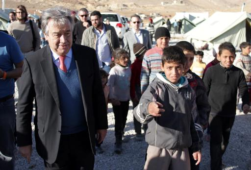 United Nations High Commissioner for Refugees, Portuguese national Antonio Guterres (L) is followed by children as he visits the Arsal refugee camp in Lebanon's Bekaa valley on November 29, 2013  (AFP/File)
