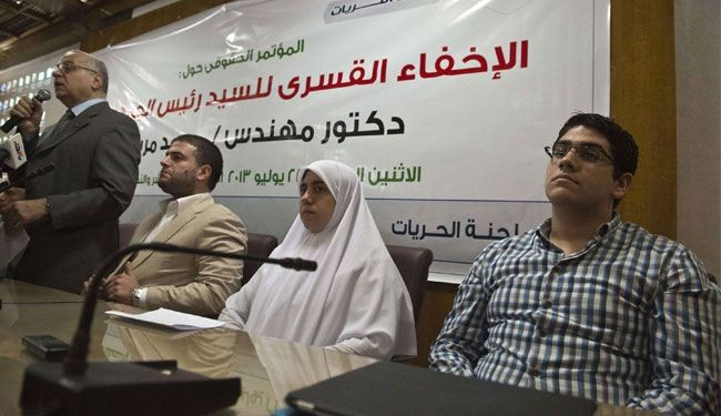 Children of Egypt's ousted president Mohamed Morsi, Osama, left,, Shaimaa, centre, and Abdulah, right, Mohamed Morsi, listen during a press conference in Cairo on Monday.  (AFP Photo)