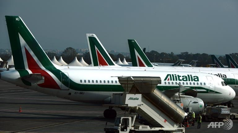 Italian airline Alitalia is considering creating a separate company to hive off its bad debts and appease Gulf-based suitor Etihad, Il Messaggero daily said on Saturday. (AFP Photo)