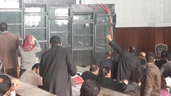 Relatives of defendants in 25 January trial case on 3 March managed to enter court,wave to them through dark glass cage ( Photo by Amira El-Fekki)