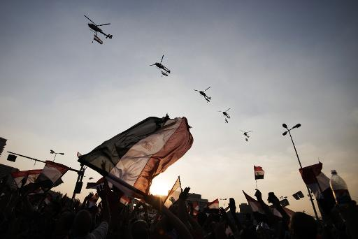 Egyptians wave the national flag as army helicopters fly above Egypt's landmark Tahrir square on July 4, 2013 (AFP/File, Gianluigi Guercia)