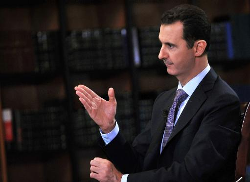 Picture released by the official Syrian Arab News Agency (SANA) on September 29, 2013 shows President Bashar al-Assad gesturing during an interview in Damascus (SANA/AFP/File)
