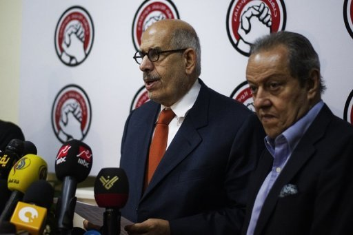 Mohamed ElBaradei, who leads the opposition National Salvation Front (L), gives a press conference on June 27, 2013 in Cairo. (AFP Photo)