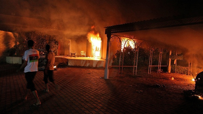 A vehicle and the surround buildings burn after they were set on fire inside the US consulate compound in Benghazi late on September 11, 2012 (AFP FILE PHOTO)