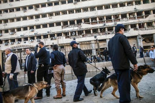 Police guard the scene of a car bomb explosion outside the Cairo police headquarters, on January 24, 2014  (AFP/File, Mahmoud Khaled)