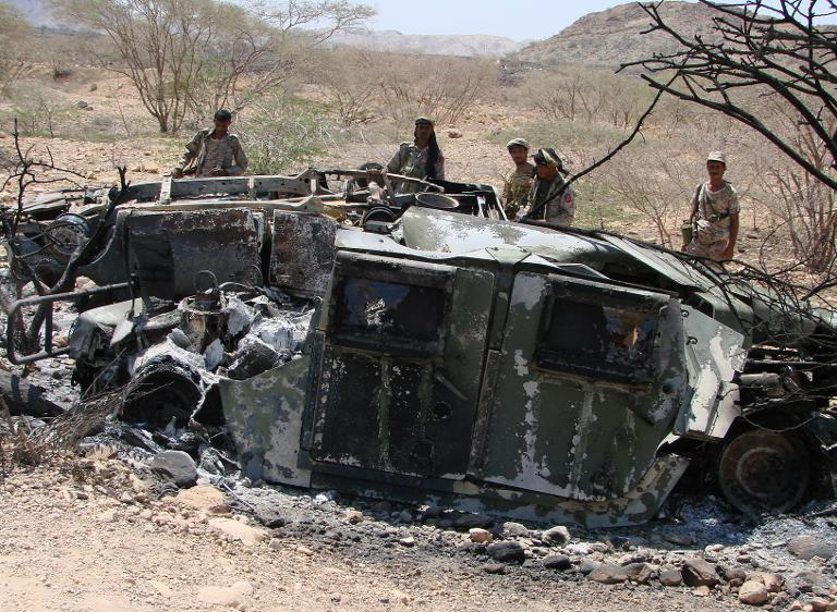 Wreckage of a vehicle following fighting between Yemeni troops and suspected Al-Qaeda militants near the southern Abyan province village of Maajal on May 2, 2014  (AFP Photo)