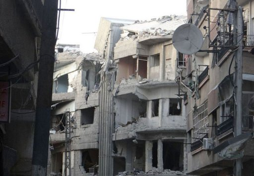 Destroyed buildings in Harasta, east of the capital Damascus (Shaam News Network/AFP/File)