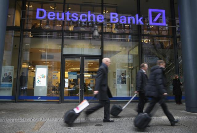 Germany's biggest bank has been embroiled in a number of scandals, with a jump in litigation costs partly responsible for the surprise fourth-quarter loss it reported last month. (AFP Photo)