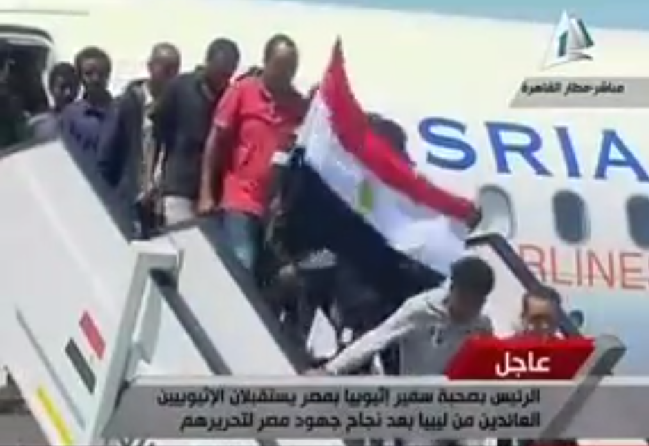 Freed Ethiopians arrive at Cairo airport after having been kidnapped in Libya (Photo screenshot from state media)