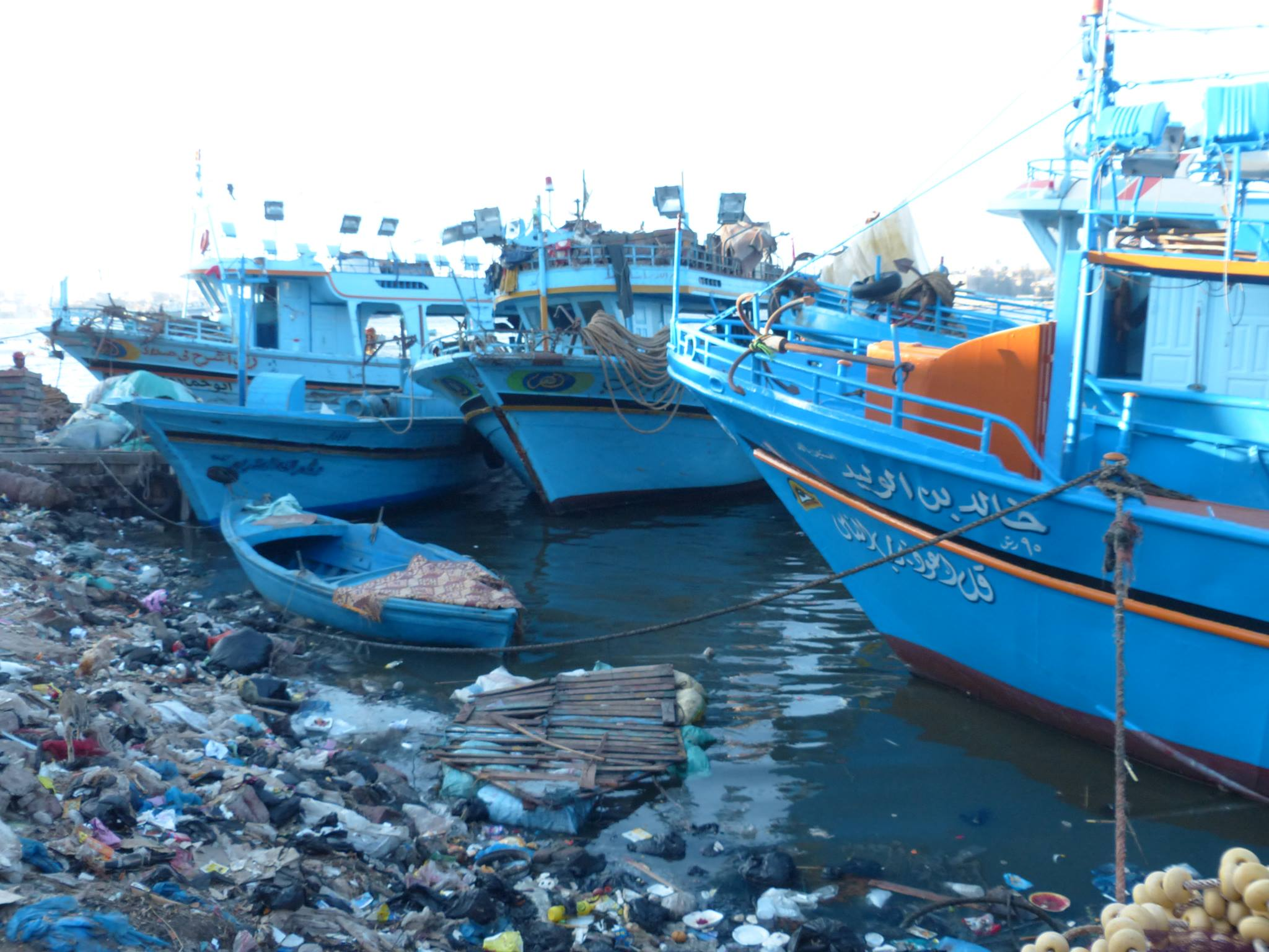 Fishing boats, lying in the harbour of a small village near Kafr El-Sheikh, are used for trafficking refugees from Egypt to Italy (Photo by Kenneth Changpertitum)