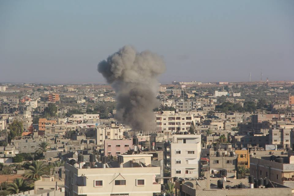 Possible war crimes include the shelling of living areas by Israeli troops and airplanes, and the indiscriminate rocket and mortar fire by Hamas directed at Israeli civilians. (Photo Handout from the Palestinian Ministry of Interior in Gaza)