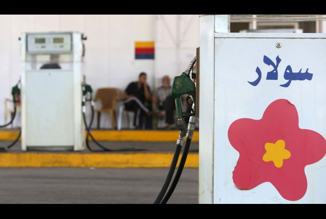 Palestinian men sit in a petrol station, which receives gas from neighbouring Egypt, in Gaza on June 29, 2013. (AFP Photo)
