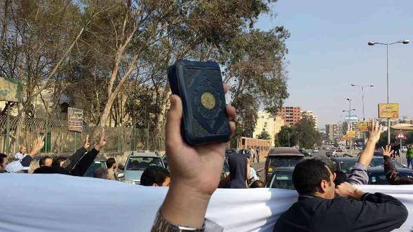 Quran held in Friday protest, Cairo (Handout from Salafi Front)
