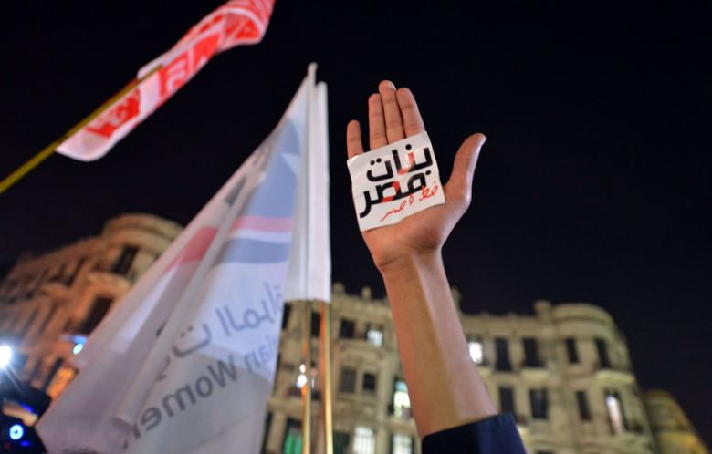"""An Egyptian protester hold up his hand with a slogan reading in Arabic: """"Egyptian girls are a red line"""" during a demonstration in Cairo against sexual harassment on 12 February 2013.  (AFP Photo \ Khaled Desouki)"""