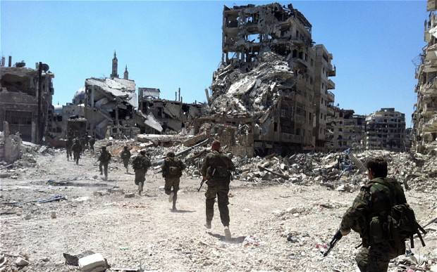 A deal between Syria's government and rebels for opposition fighters to leave the Old City of Homs will be implemented in the next 48 hours, the provincial governor said Monday. (AFP Photo)