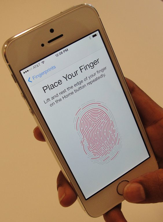 A new iPhone 5S handset, which lets the user unlock  the phone with a fingerprint (AFP Photo)