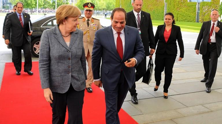 Egypt's President Abdel Fattah Al-Sisi and German Chancellor Angela Merkel