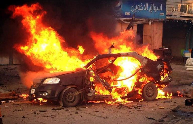 A blaze engulfs a car at the scene of an explosion in the Shiite Muslim Al-Amin district of Baghdad on December 8. (AFP Photo)
