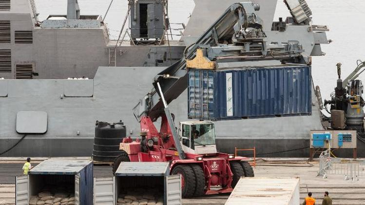 Israeli soldiers inspect containers unloaded from the Panamanian-flagged Klos-C vessel on at a navy base near the southern Israeli port of Eilat.  (AFP/Jack Guez)