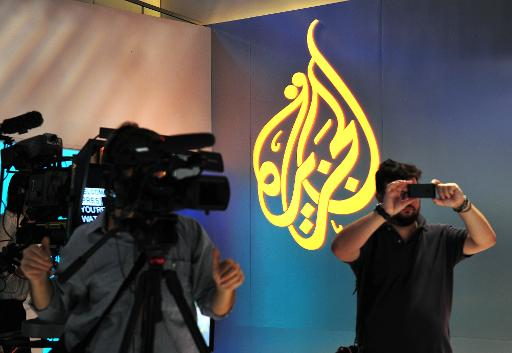 Egyptian authorities have been incensed by Al-Jazeera's coverage of their campaign against Islamists and have accused the Qatari channel of ties to the Muslim Brotherhood  (AFP/File, Stan Honda)
