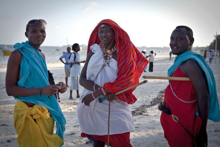 Samburu men wait to sell traditional crafts to tourists on Bamburi beach in the coastal city of Mombasa on February 22, 2014  (AFP Photo/Ivan Lieman)