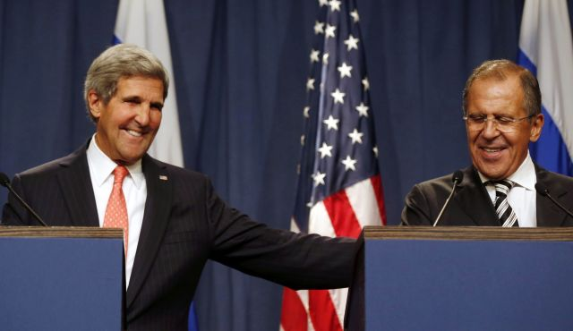 U.S. Secretary of State John Kerry holds a joint press conference with Russian Foreign Minister Sergei Lavrov in Geneva on September 14, 2013 after they met for talks on Syria's chemical weapons. (AFP Photo)