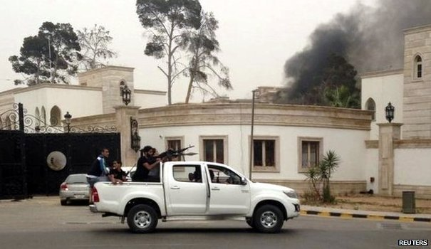 Smoke was seen rising from the parliament building in Tripoli.  (AFP Photo)