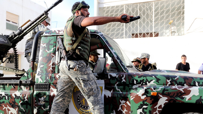 "A file photo taken on November 4, 2012 shows Libyan state security forces known as the ""National Mobile Forces"" patroling in the Libyan capital, Tripoli.  (AFP PHOTO/MAHMUD TURKIA)"
