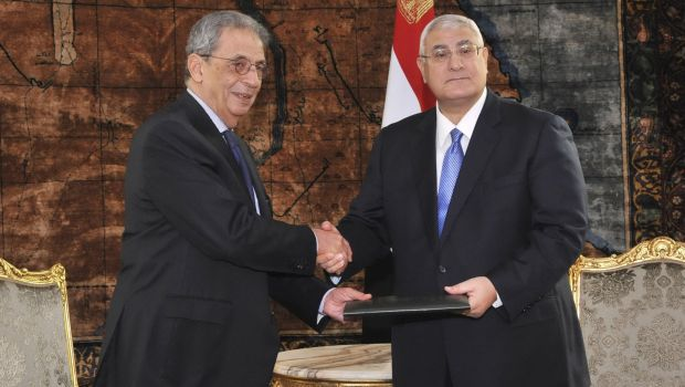 Interim President Adly Mansour receives a finalised draft constitution from Egypt's constituent assembly chairman, Amr Moussa, during their meeting at Al-Ittihadiya presidential palace in Cairo on 3 December 2013 (Photo handout by Egyptian Presidency)