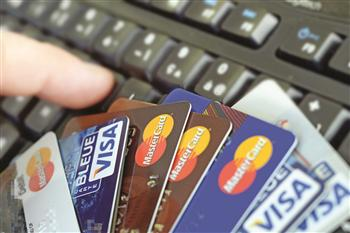 The level of credit card penetration in Egypt remains low despite its worldwide presence. (AFP Photo)