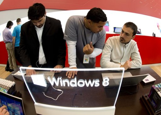 Customers get a look at products at Microsoft's pop-up store on October 26, 2012 in New York (AFP/File, Don Emmert)