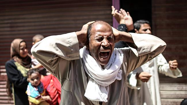 An Egyptian man reacts outside the courtroom in Egypt's southern province of Minya. (AFP Photo)