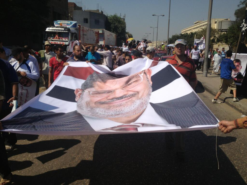 Massive Morsi poster on the ground before Rabaa sit in (Photo by Basil ElDabh/DNE)