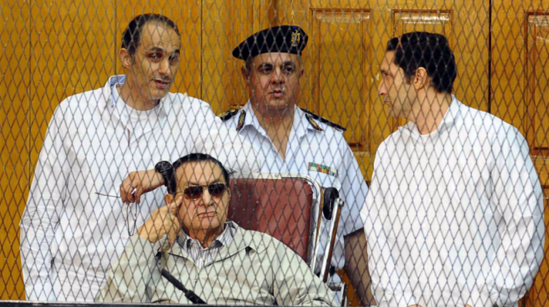 Hosni Mubarak with his two sons Gamal Mubarak and Alaa Mubarak during a trial after 2011