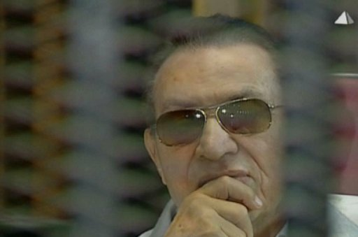 Ousted Egyptian president Hosni Mubarak, behind the defendant's cage at the Police Academy in Cairo on June 8, 2013 (AFP/File)