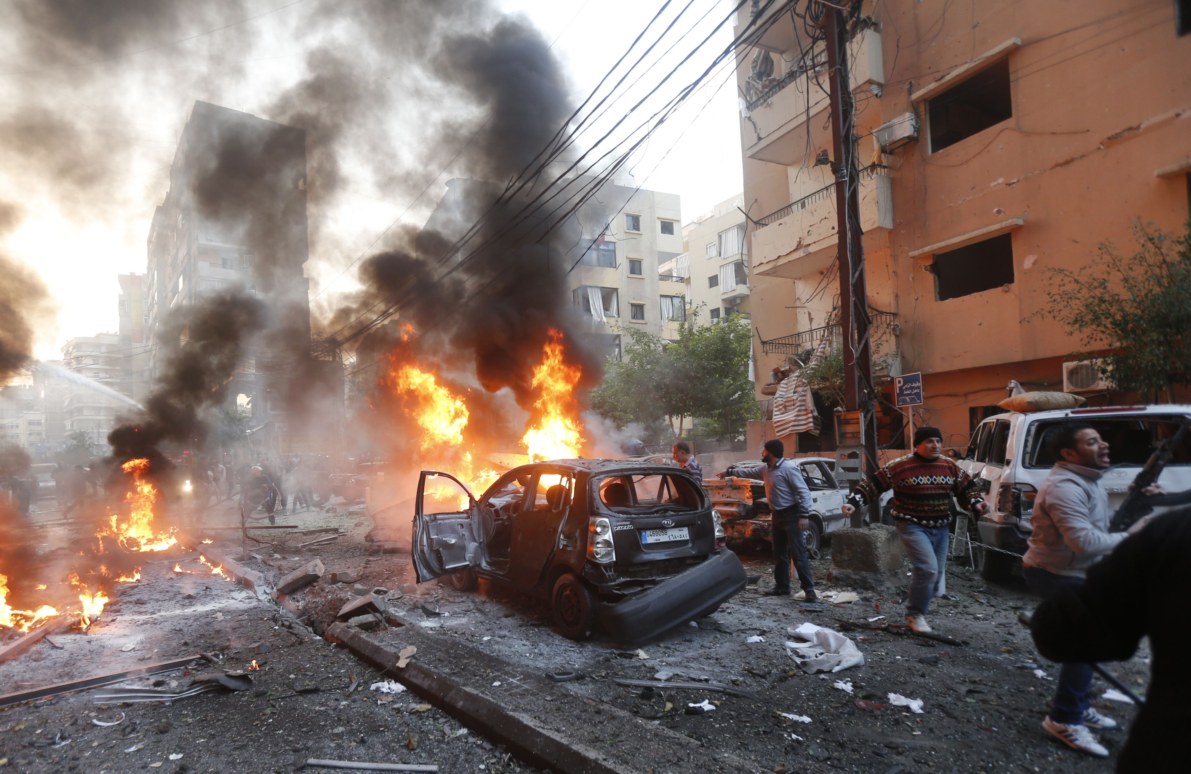Flames rise from burning cars at the site of a car bomb that targeted Beirut's southern suburb of Haret Hreik on January 2, 2014. A large car bomb killed five people and wounded at least 20 in south Beirut, a health ministry source told AFP. ( AFP PHOTO/STR)