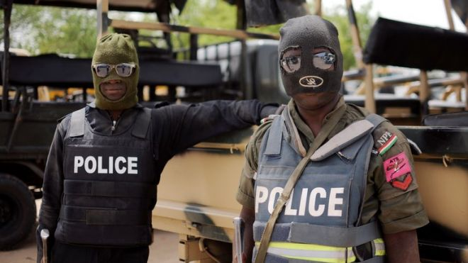 Nigerian police, part of the joint forces in Borno state, pose prior to a patrol in Maiduguri on June 5, 2013.  (AFP/File)
