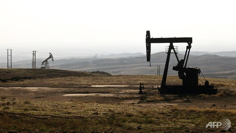 Oil rigs in the Kurdish town of Derik in the northeastern Hasakeh governorate on the border with Turkey and Iraq on November 25, 2013.  (AFP/Achilleas Zavallis)