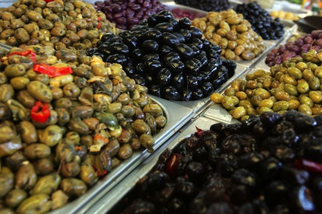 Olives and olive oil comprise the majority of food items exported (AFP Photo)