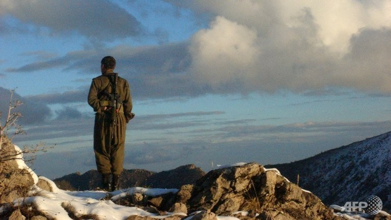 Photo obtained  from the Firat News Agency shows a fighter of the outlawed Kurdistan Workers' Party (PKK) in an undisclosed mountainous region in Turkey near the border with Iraq.  (AFP Photo)