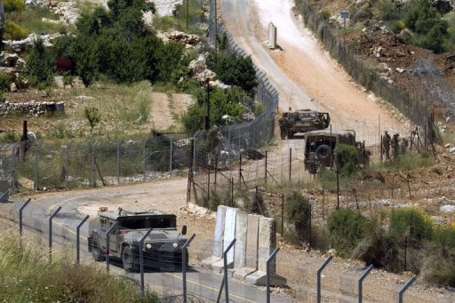 Israeli soldiers patrol the border fence between the Golan Heights and Syria next to the Druze village of Majdal Shams, on June 3, 2011. The Israeli military has confirmed that mortar fire from inside war-torn Syria landed in the Golan Heights. (AFP Photo)