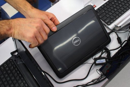 A customer looks at a Dell computer on February 5, 2013 in Miami, Florida. With a critical vote looming on a private equity buyout for Dell, it has become clear the struggling computer giant faces a tough road as it tries to revive its fortunes. (AFP Photo)