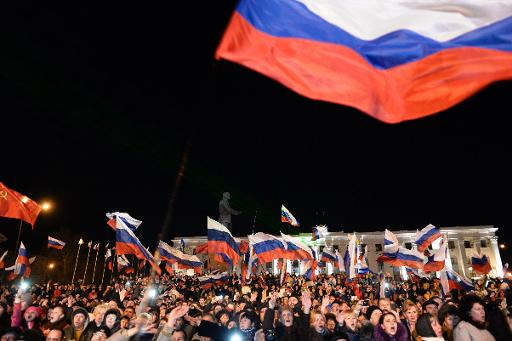 Pro-Russian Crimeans gather to celebrate in Simferopol's Lenin Square on March 16, 2014 after exit polls showed that about 95 percent of voters in Ukraine's Crimea region support union with Russia  (AFP, Dimitar Dilkoff)