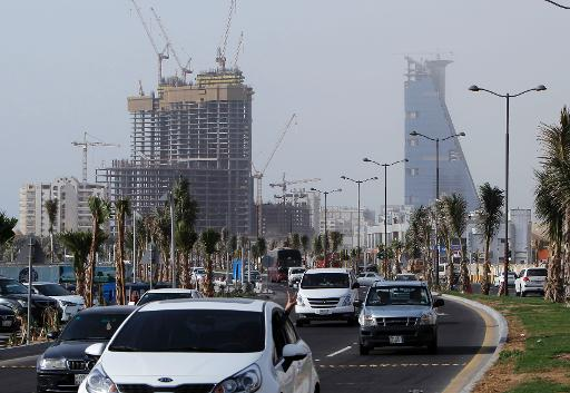 Cars drive past a building under construction in the Saudi coastal city of Jeddah on March 16, 2013 (AFP/File, Khaled Saad)