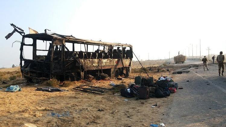 A picture uploaded on the official Facebook page of the Egyptian army spokesperson on November 20, 2013 shows a burnt-out army bus following a car bomb attack in North Sinai (AFP Photo)