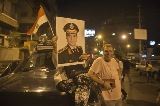 An Egyptian protester carries a portrait of army chief General Abdel Fattah al-Sisi in Cairo on July 1, 2013 (AFP/File, Khaled Desouki)