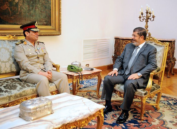 A handout picture released by the Egyptian presidency shows Egyptian president Mohamed Morsi (R) meeting with newly appointed Egyptian Defence Minister Abdel Fattah al-Sissi (L) at the presidential palace in Cairo on August 13, 2012. Egypt's Islamist President Mohamed Morsi ordered the surprise retirement of his powerful defence minister Field Marshal Mohammed Hussein Tantawi, replacing him with Sissi, and scrapped a constitutional document which handed sweeping powers to the military.  (AFP PHOTO/HO/EGYPTIAN PRESIDENCY)