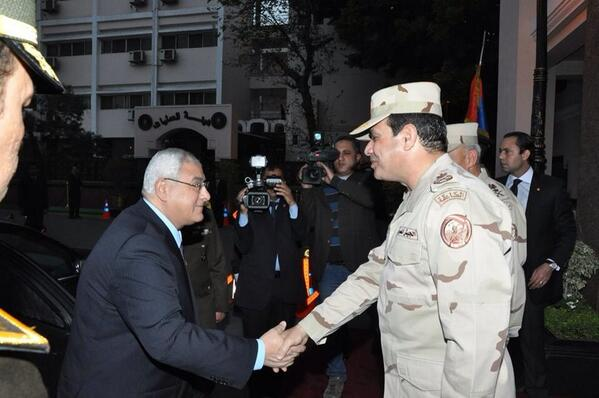 Field Marshal Abdel Fattah Al-Sisi (right) shakes hands with interim President Adly Mansour before the start of Wednesday's Supreme Council for Armed Forces' meeting